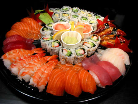Party tray of sushi and rolls photo