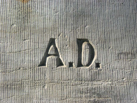anno: Letters A.D. - Anno Domini on the wall of an old church Stock Photo