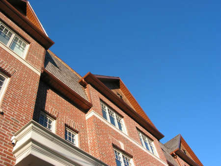 New brick townhomes on the background of bright blue sky photo