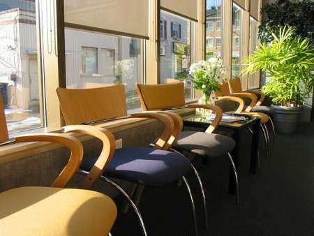 Row of brightly colored chairs in a doctors office on sunny morning photo