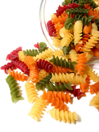 Colorful dry pasta in a jar on white background photo