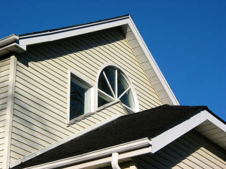 Fragment of a house on with bright blue sky
