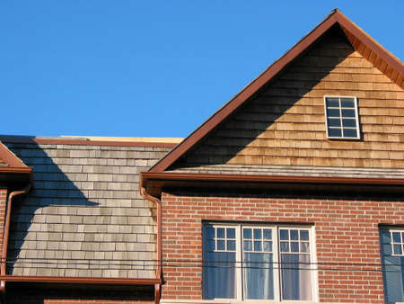 townhomes: New brick townhomes on the background of bright blue sky