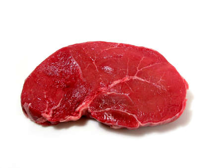 Raw steak isolated on white background Фото со стока