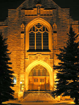 Beautifully illuminated church building at night photo