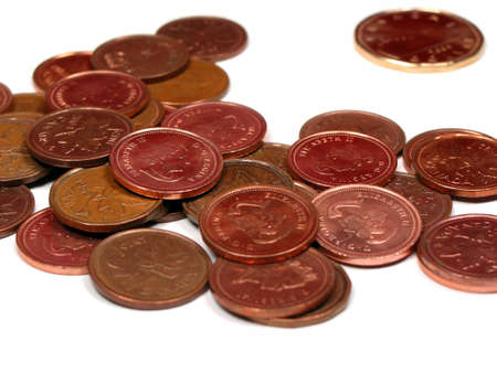 Canadian coins: pennies and dolllar, isolated on white background Imagens