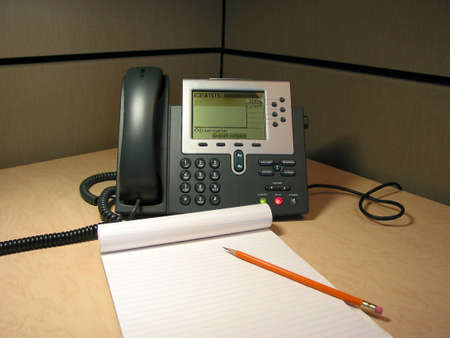 dial pad: IP phone on the desk in the office with pencil and notepad Stock Photo