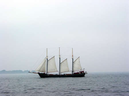 tall ship: Tall ship sailing on a foggy day Stock Photo