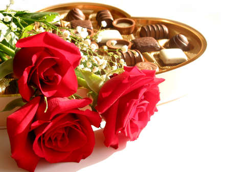 Red roses with heart-shaped box of chocolates on white background Stock Photo - 360617