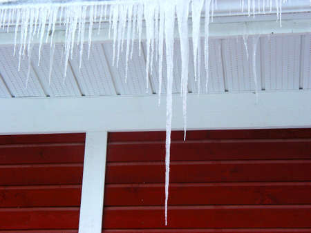 edge: Icicles on a roof edge Stock Photo
