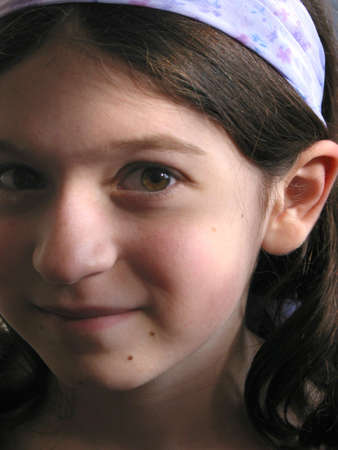 hairband: Portrait of a young girl with brown hair and purple hairband