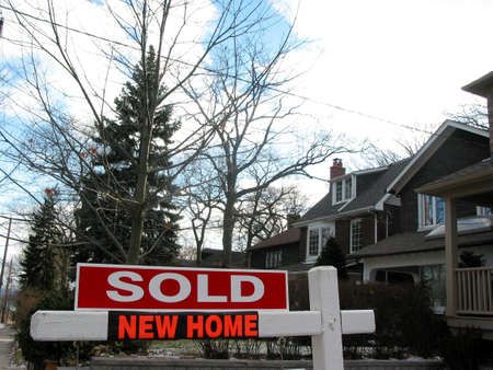 newly: Sold sign next to a newly built house Stock Photo