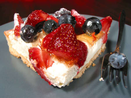 Slice of mixed berry tart on a plate, closeup Stock Photo - 366655