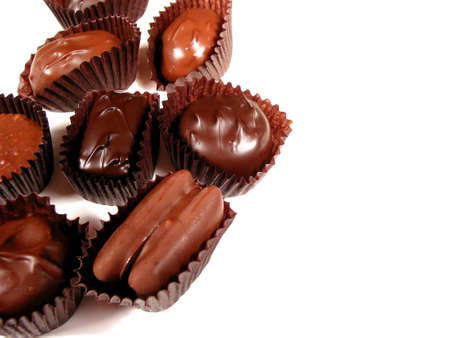 Several chocolates on white background, closeup