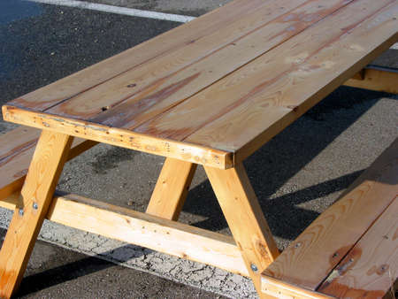 Wooden picnic table on parking lot