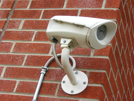 Security camera on a brick wall of a residential building photo