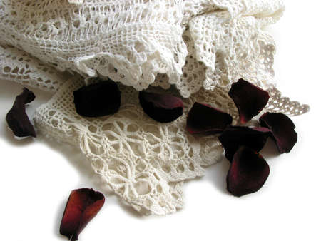 Vintage lace with dried rose petals
