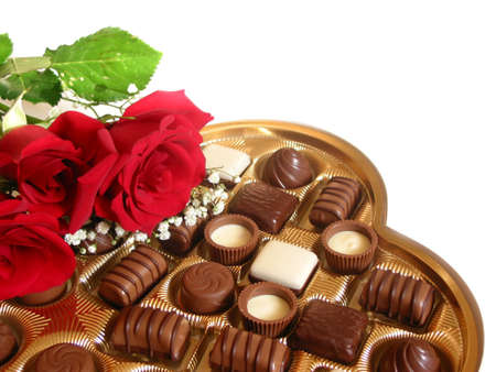 confectionary: Heart shaped box of chocolates with red roses isolated on white background