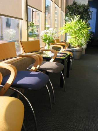 brightly: Row of brightly colored chairs in a doctors office on sunny morning