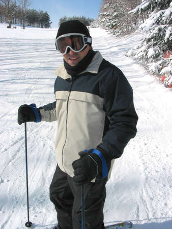Happy man enjoying downhill skiing Stock Photo - 366587