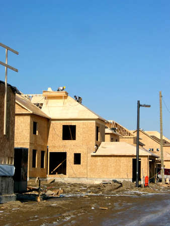 Construction of a new home with workers on roof