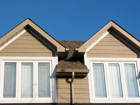 Detail of a brand new house on a bright blue sky background photo