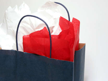 tissue paper: Blank blue shopping bag on white background with tissue paper Stock Photo