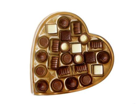 shaped: Heart shaped box of chocolates isolated on white background