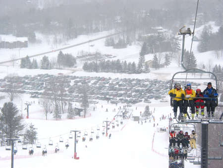 View from the top of a hill at Horseshoe ski resort, Ontario, falling snow photo