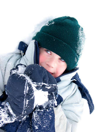 Young boy playing in snow