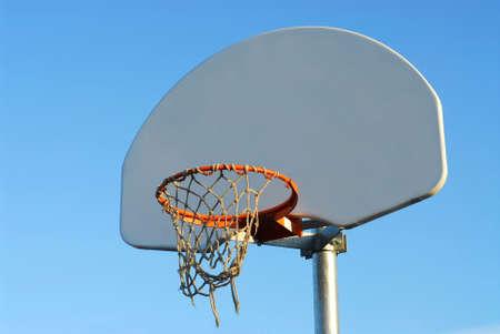 backboard: Basketball backboard with torn net