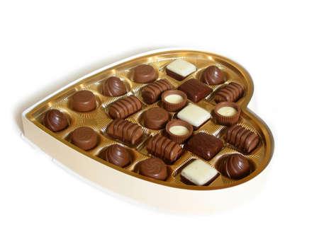 shaped: Heart shaped box of chocolates on white background Stock Photo