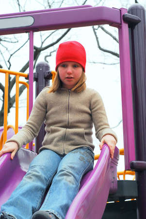 Young girl on a playground, about to go down the slides Stock Photo - 368941