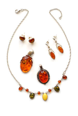 Amber jewelry on white background photo