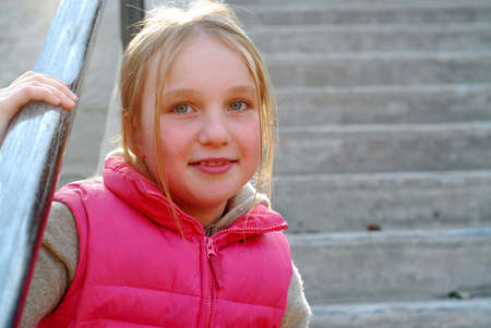 Young girl sitting on concrete stairs photo