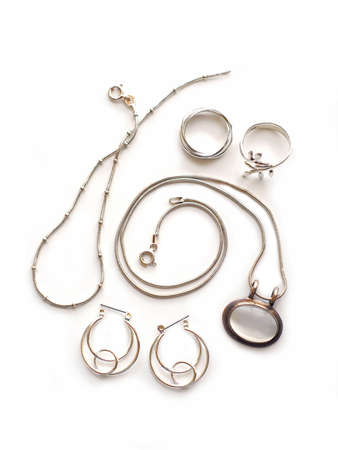 Silver jewelry on white background Imagens
