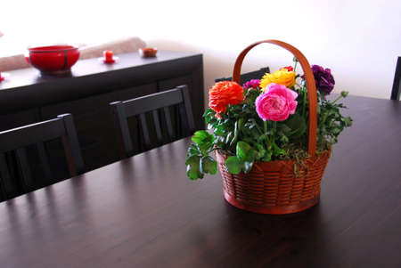 flower basket: Flower basket on a dining room table Stock Photo