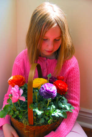 Young girl with flower basket, soft focus