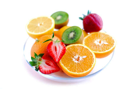 Fruits in a bowl on white background