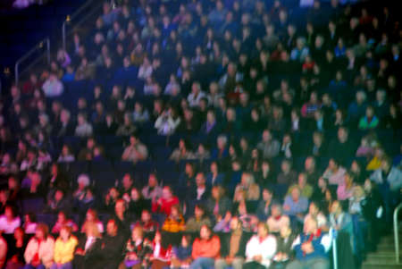 intentionally: Spectators in an arena, image is blurred intentionally to remove detail Stock Photo