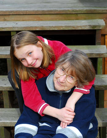 Grandmother and granddaughter happy together Stock Photo