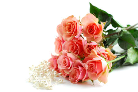 Bouquet of pink roses with pearls on white background