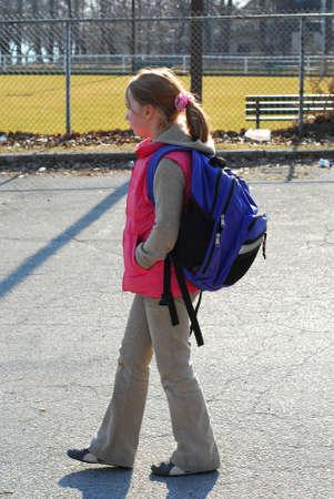 School girl walking Zdjęcie Seryjne