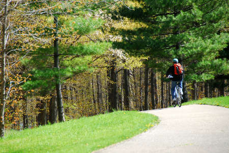 Man on bicycle on a trail