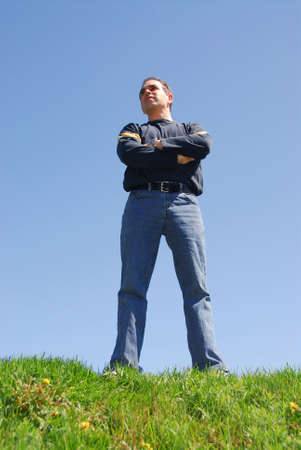 Man standing on top of a hill, looking to the future Stock Photo - 401271