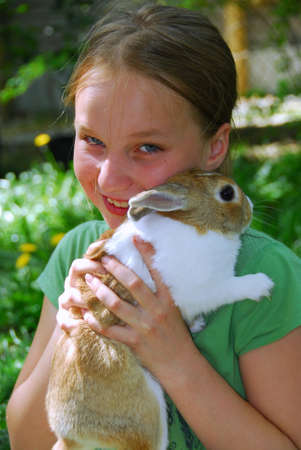 Pretty girl holding a bunny photo