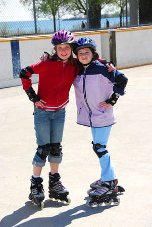 rollerblading: Two young girls rollerblading Stock Photo