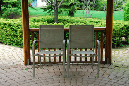 patio chairs: Two empty patio chairs