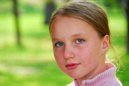Portait of young girl on green background