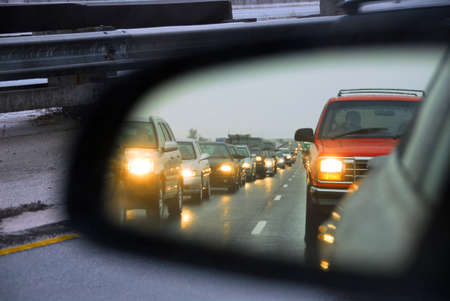 Feflection of a traffic jam in a sideview mirror Stock Photo - 408399
